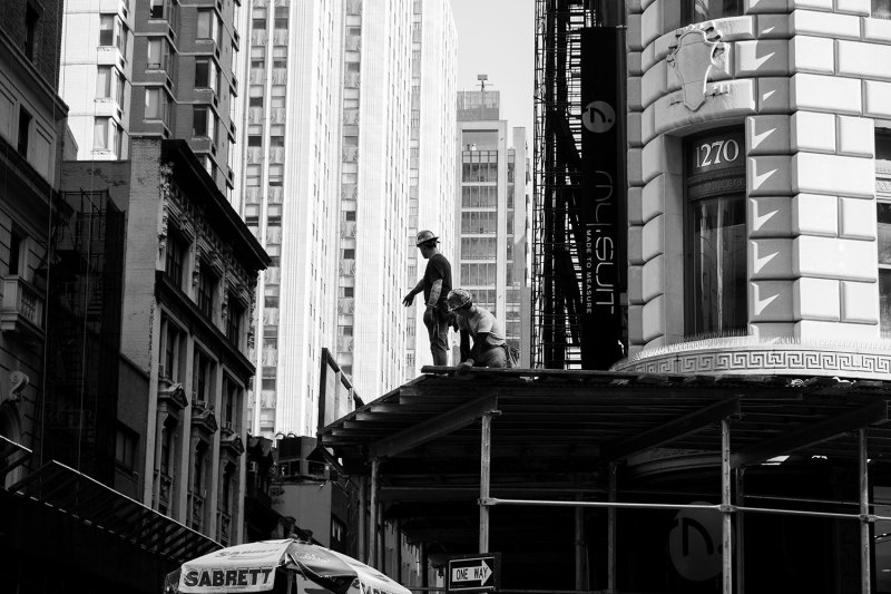 Construction workers build an awning in NYC