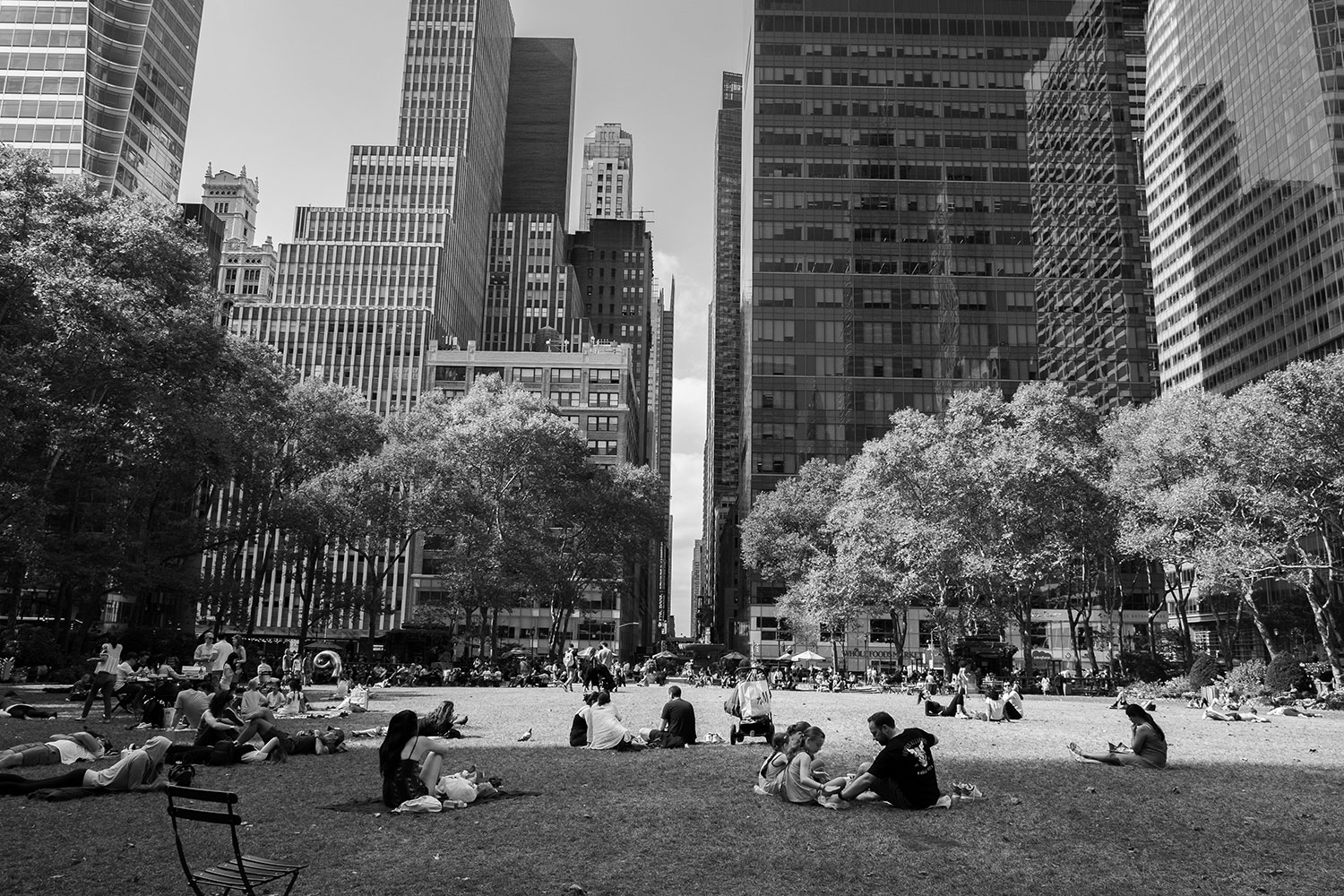 people relax on the lawn at Bryant Park