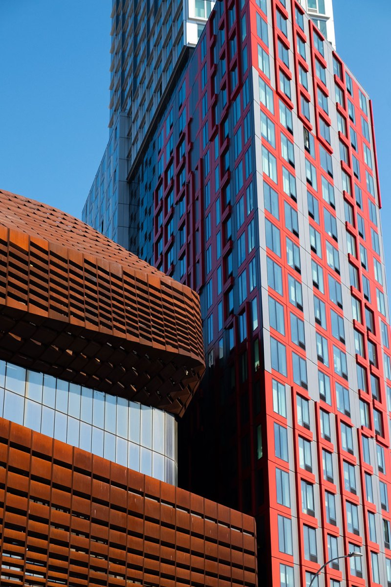 the Barclays Center against a red apartment building