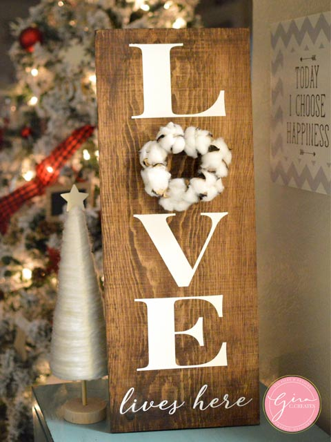 LOVE LIVES HERE WOOD SIGN WITH COTTON BALL WREATH