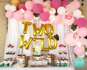 tropical pink and gols dessert table balloon garland two wild