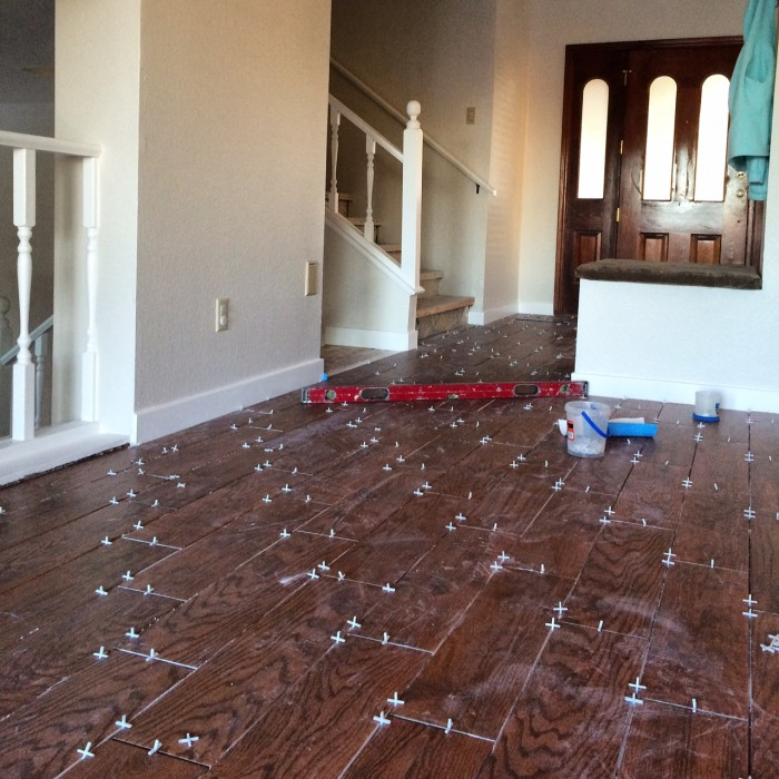 Wood tile flooring renovation diary gina demillo wagner for Parquet renovation