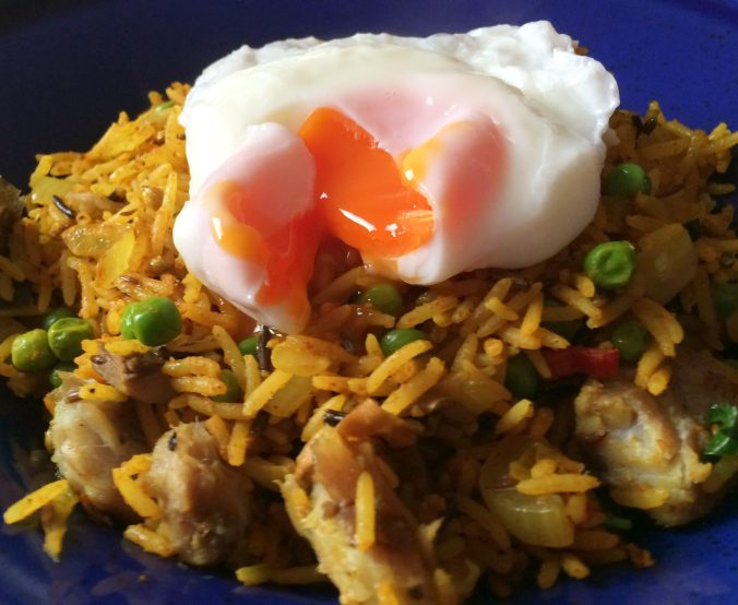 Close up of the finished mackerel kedgeree with the poached egg releasing its delicious yolk, glorious!
