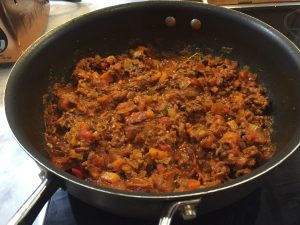 Shot showing the bolognese sauce cooked down and ready to serve.