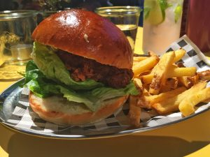 Shot showing the fried chicken burger with fries, a great dish.