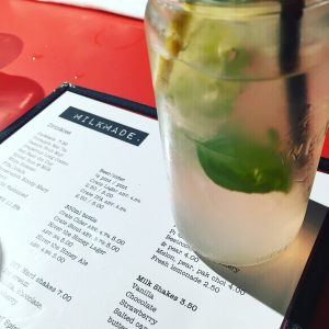 Shot showing the cocktail menu and red basil gin cup.