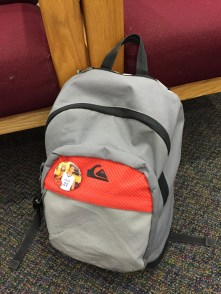 Student backpack with button