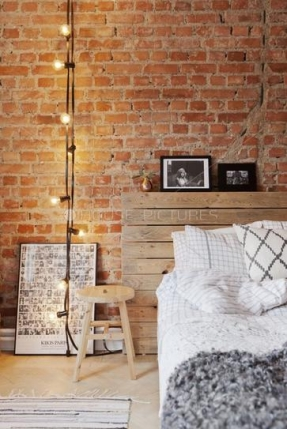 25-gorgeous-bedroom-decorating-ideas-exposed-brick-walls-wooden-headboard-mixed-with-diamond-grid-pattern-pillows-a-modern-wooden-stool-as-a-nightstand-string-lights-gray-shaggy-throw