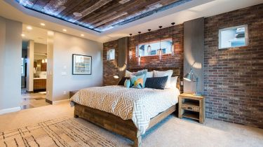 Reclaimed-wood-ceiling-and-exposed-brick-walls-in-the-bedroom