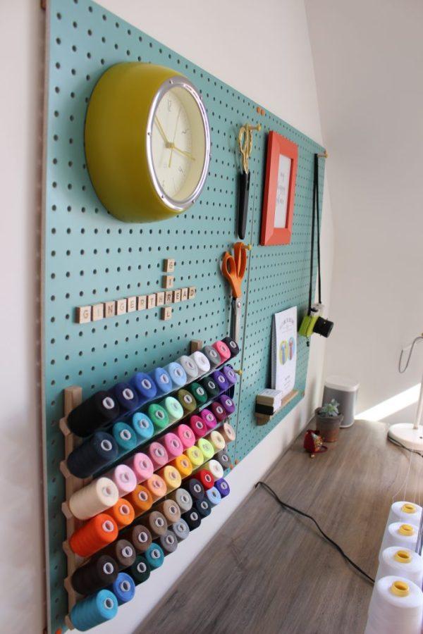 Pegboard - Block Design, Thread rack - Amazon, Clock - Habitat, Desk - French Connection, Orange frame - Habitat