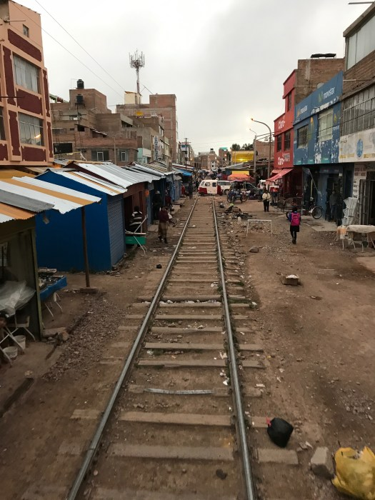 Market stall centimetres away from the Andean Explorer train