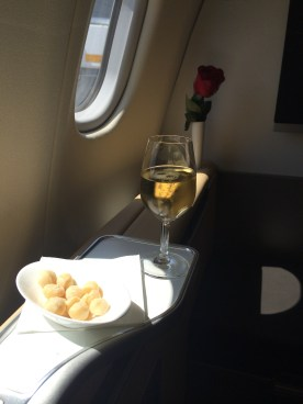 Lufthansa First Class pre-departure champagne and macadamia nuts