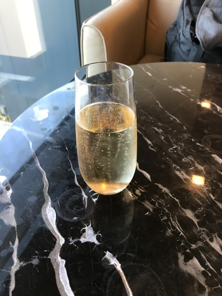 Glass of champagne in the Singapore Airlines lounge at Heathrow Terminal 2