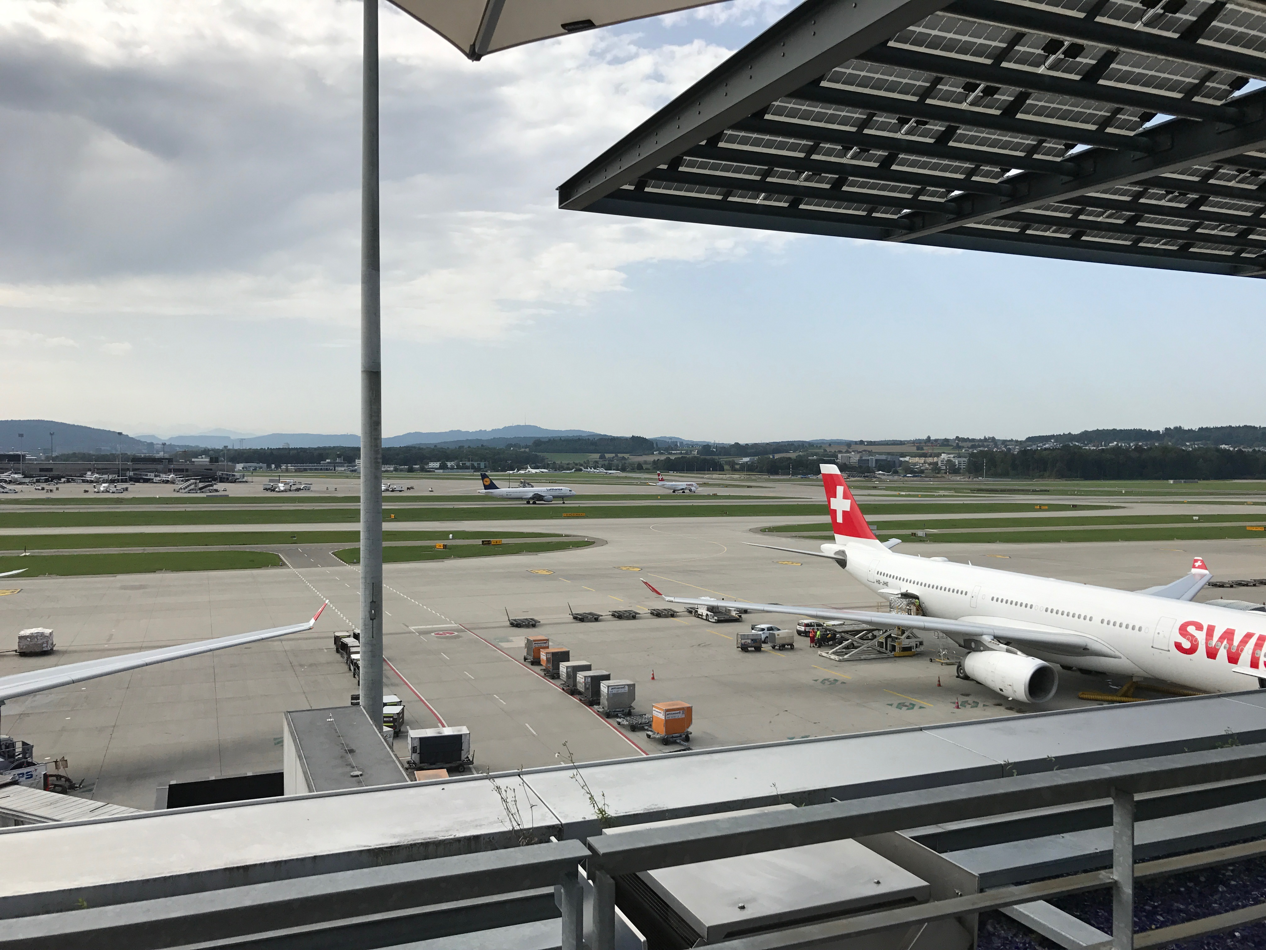 Looking at the active runway at Zurich from the Swiss First Class Lounge at Zurich terrace