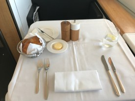 Swiss 777-300 first class table laid out for service