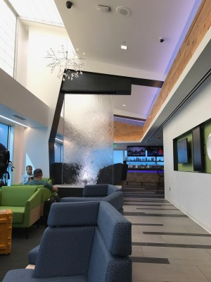 Alaska Airlines lounge SeaTac Airport water feature and seating area