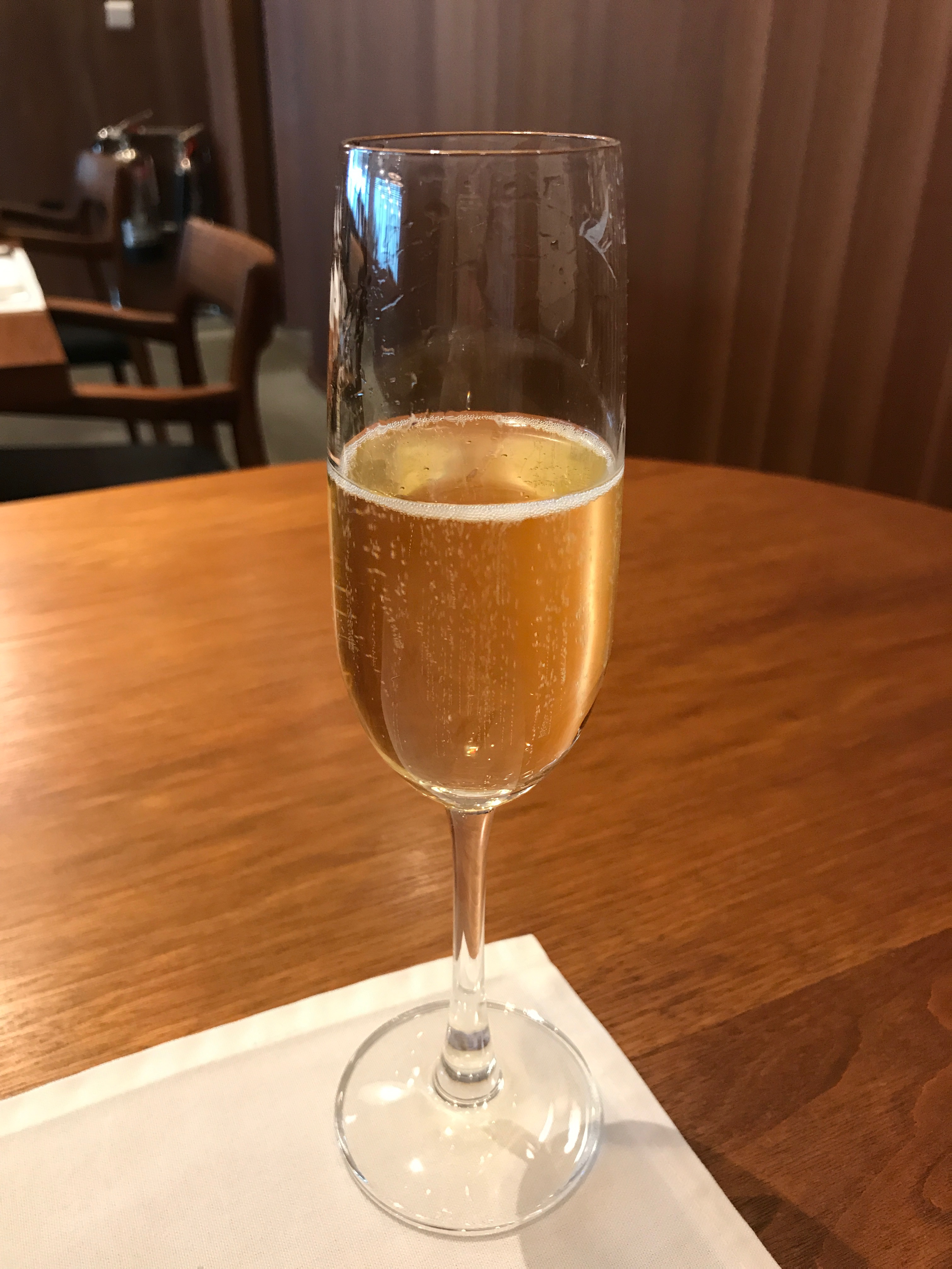 a class of champagne in the lounge at Heathrow terminal 3