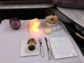 Qatar airways business class q-suite laid table