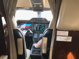 Cabin view of a Phenom 300 looking forwards