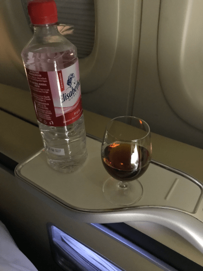 Lufthansa First Class cognac and water