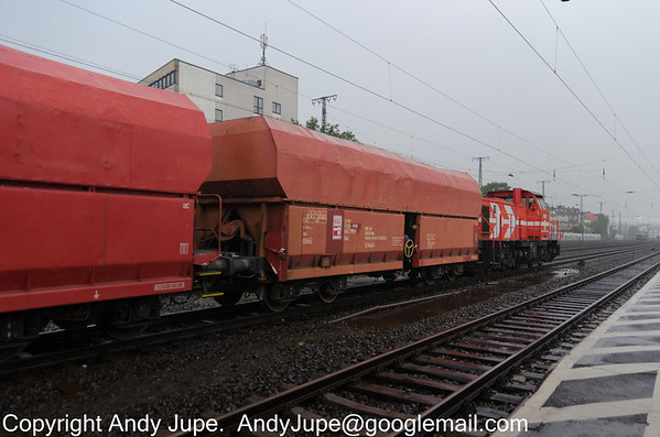 Fals 33 52 6651 990-9 owned by HGK, passes through a very wet Köln West station on the 10th of  October 2013.