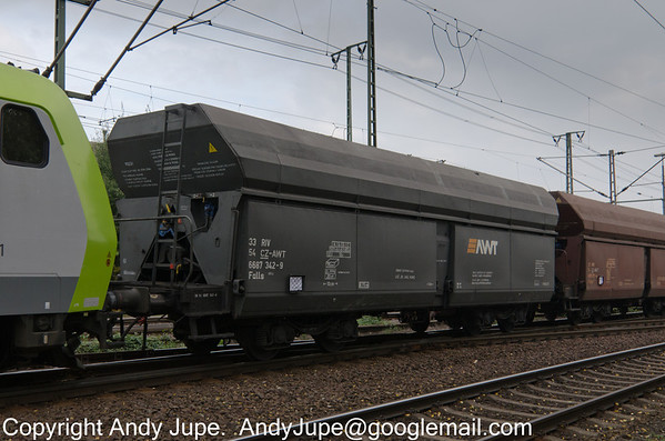 Advanced World Transport (AWT) registered wagon, Falls 33 54 6687 342-9 passes through Lehrte near Hanover in Germany on the 9th of October 2013.