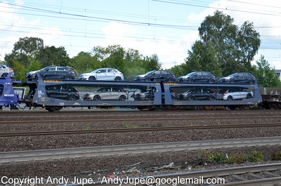 French registered car transporter Laeks 25 87 4272 704-9 passes through the eastern side of Hamburg Harburg station, Germany on the 17th July 2012