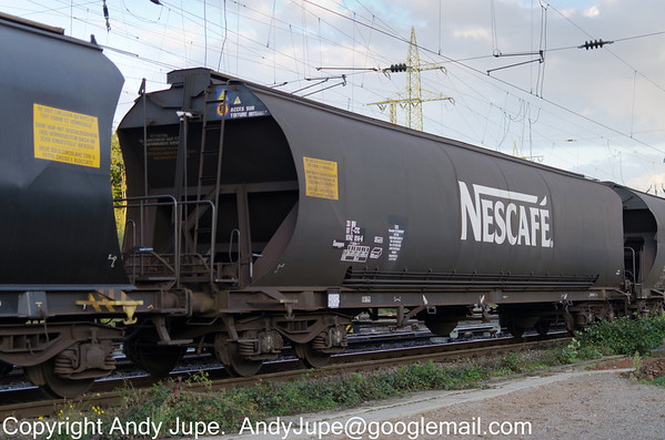 Nescafe liveried French registered wagon Uanpps 33 87 9342 014-6 passes through Gremburg Yard, Köln on the 10th of October 2013