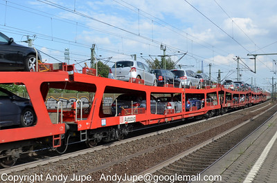 Autozug DDm 51 80 9880 015-5 passes through Hamburg Harburg station, Germany on the 18th July 2012
