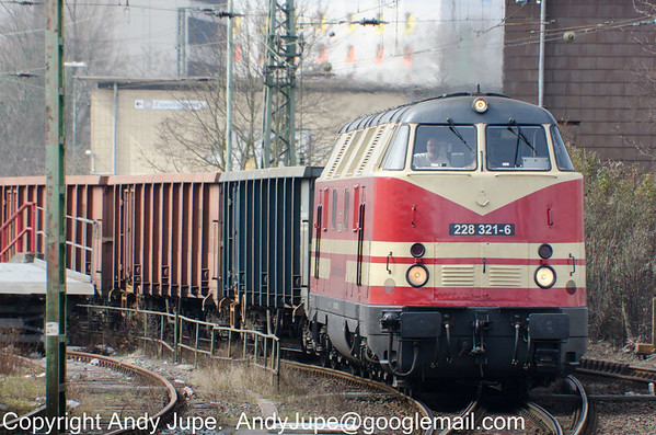 228 321-6 rounds the curve at Bremen Hbf hauling a train of open box bogie wagons on the 12th of April 2013.