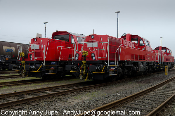 Three Voith Gravita 10 BB locomotives, numbers 261 077-2, 261099-6 & 261037-6 sit in Itzehoe Yard, Germany on the 19th of May 2013.