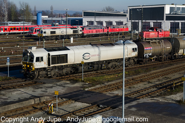 EMD type JT42CWRM number 266 448-0 in EuroCargo Rail livery arrives at Mühldorf, Germany on the 16th of December 2013
