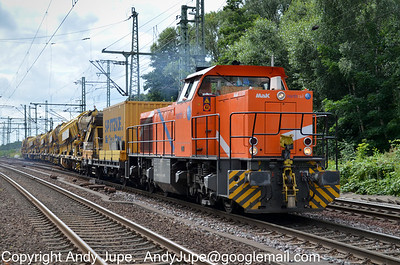 In NorthRail bright orange Class 275 number 275 804-3 exits the yard to the south of Hamburg Harburg station and heads north on the 20th of July 2012