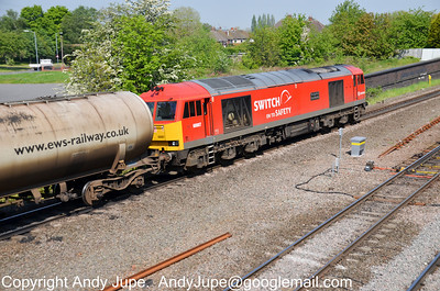 60 007 powers under the footbridge at Water Orton whilst hauling 6E41 11:41 Westerleigh to Lindsey Oil Refinery on the 23rd of May 2012