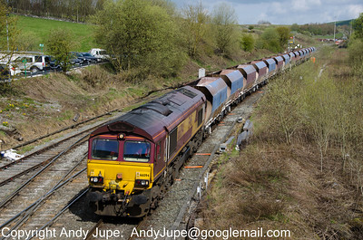66 094 approaches Great Rocks Junction with a rake of HJA Bogie Aggregate Hopper wagons on the 9th of May 2012