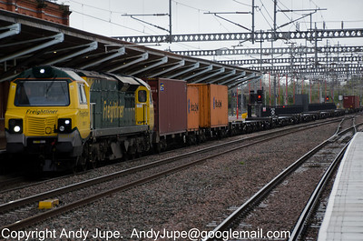 70 017 passes through a damp Rugby way back in April whilst working 4M54 10:10 Tilbury to Basford Hall Yard (Crewe) on the 27th of April 2012
