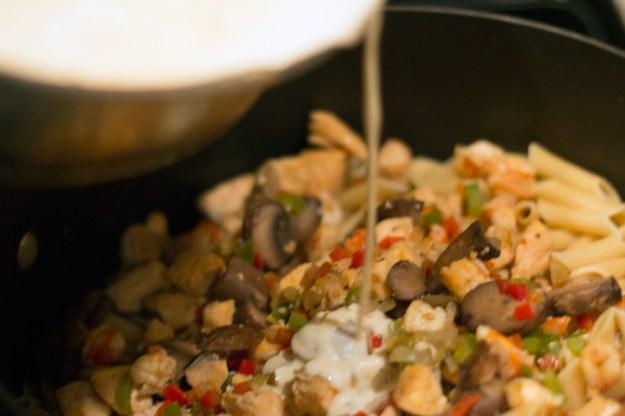 Cajun Salmon and Shrimp Penne - Add cream sauce