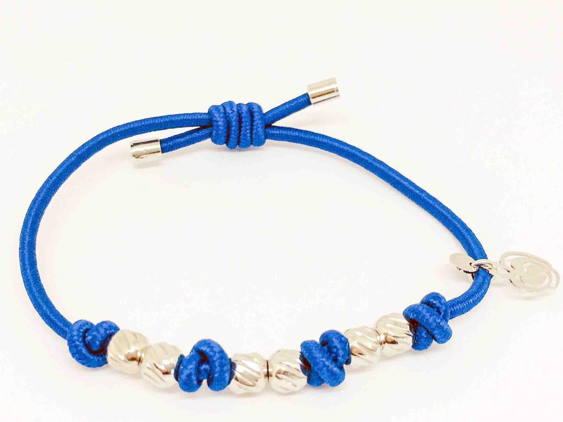 Bracciale-azzurro-elastico-per-capelli