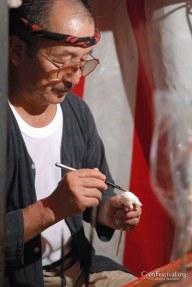 food artist painting sugar street stall gion festival kyoto japan