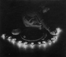 Girl laying oil lamps
