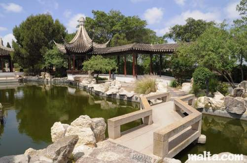 bridge-and-side-path-of-the-garden-of-serenity-in-santa-lucija