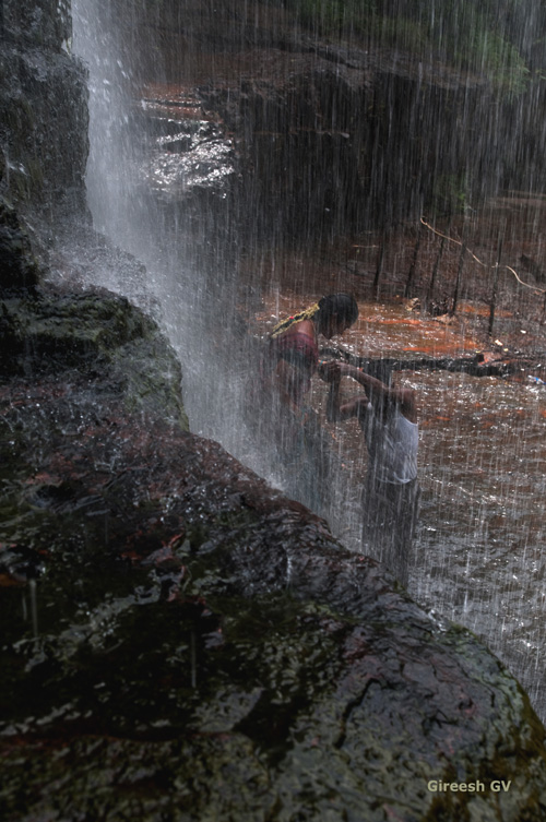 Indian couple, romancing the waterfall at Talakona, Srisailam
