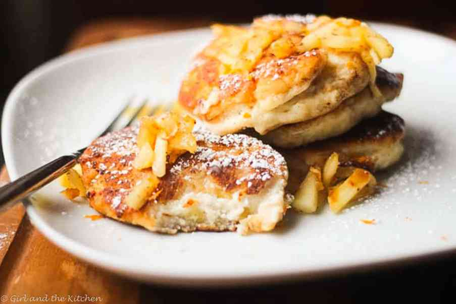 """These plump and delicious """"syrniki"""" are Russian cheese and apple fritters that are filling, healthy and creamy.  Perfect for any breakfast, brunch or snack!"""
