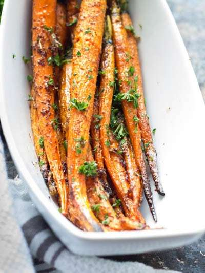 These roasted carrots are glazed with a nutty brown butter that is loaded with garlic and red pepper flakes. This easy side dish ends the age old problem of boring vegetables.