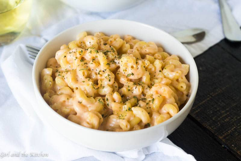 Super creamy mac and cheese made in one pot is only 20 minutes away! Loaded with three different cheeses and made right on the stove top, this easy version of an American favorite will be your favorite dinner side dish!