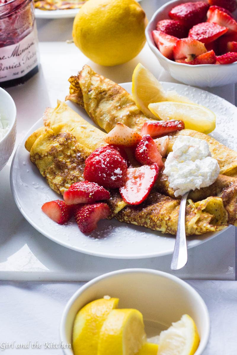 Classic Swedish Pancakes are tender, lacy crepes that are mildly sweet and perfectly delicious! A perfect breakfast that comes together in minutes and puts a smile on everyone's faces!