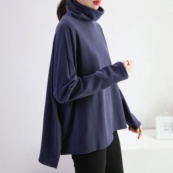 Turtleneck Batwing Sweater worn by a model turned on her side