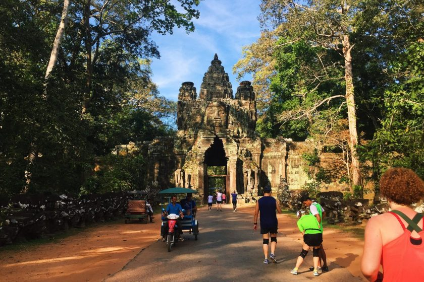 Running through one of the gates in Angkor Wat