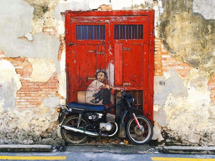 """The famous """"Boy on bike"""" Street art in Penang"""