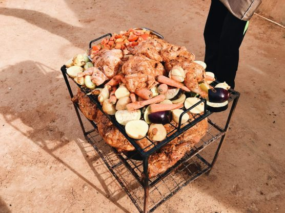 First, the meat (chicken and lamb) is marinated with spices and placed on a tray with vegetables.